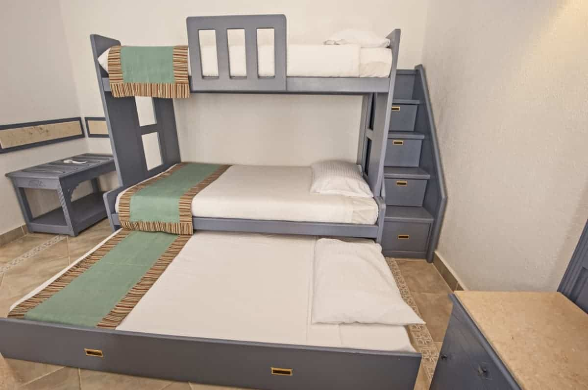 A bunk and a trundle bed in a family room.
