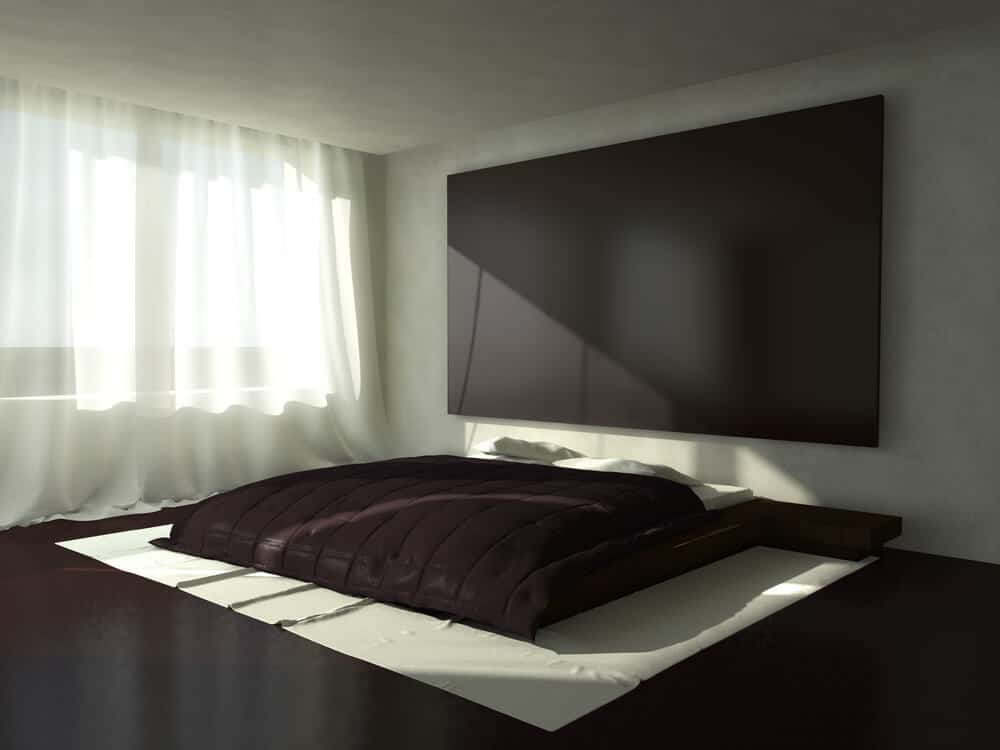 A dark platform bed with a sleek finish.
