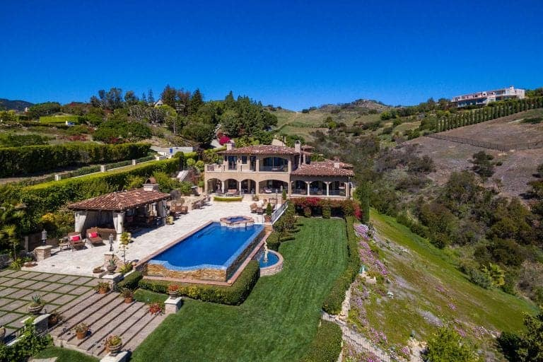 Aerial view of DeAndre Jordan's Malibu property featuring the beautiful surroundings and home structure of the mansion.