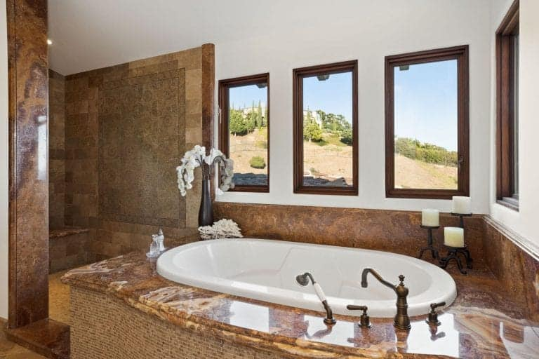The bathroom offers a drop-in tub and a walk-in shower.