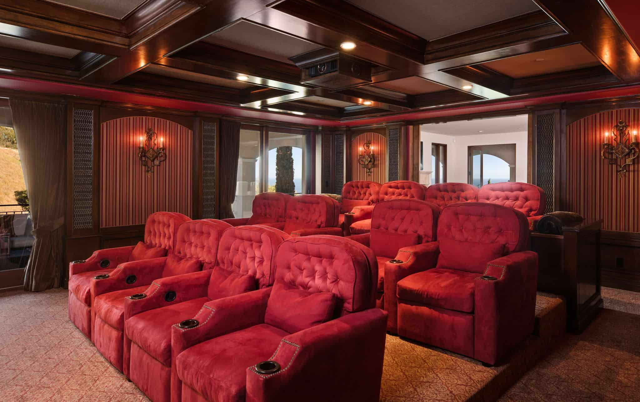 The Mansionu0027s Home Theater Features A Red Velvet Set Of Sectional Theater  Seating Perfect With The