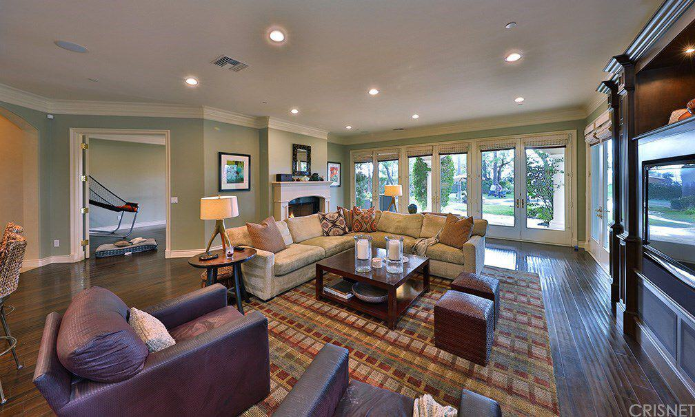 The Family Room Offers A Nice Sofa Set On A Beautiful Rug Lighted By  Multiple Recessed Ceiling Lights.