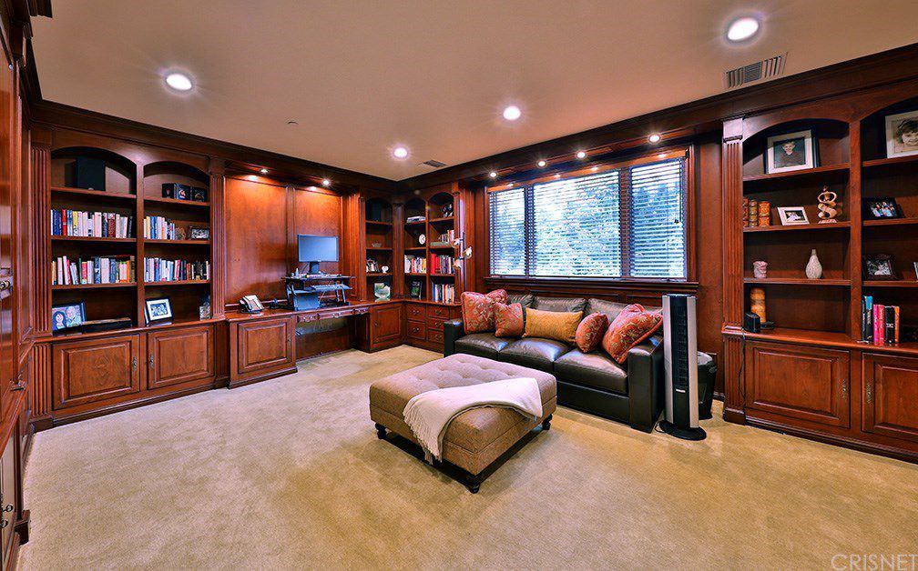 Thereu0027s Also A Home Office In The House With A Carpet Flooring And Multiple  Bookshelves Lighted