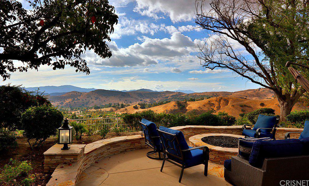 The patio has its own fire pit overlooking the beautiful outdoor landscape.