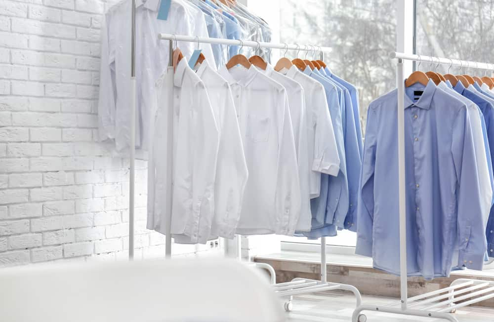 Clean clothes on drying racks.