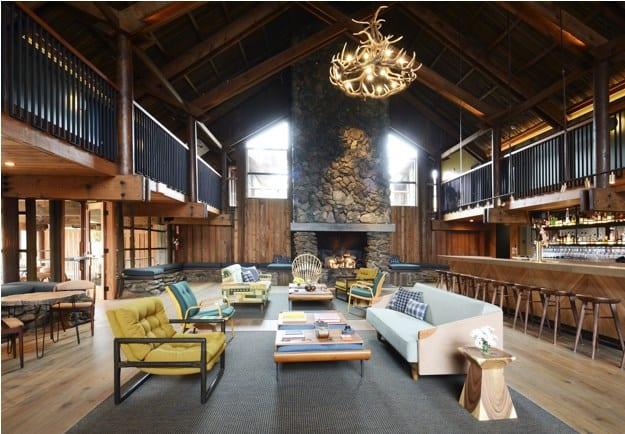 The Novogratz design incorporating mid-century furniture in rustic home.