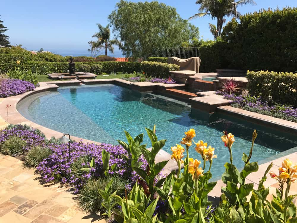 Here's a beautiful swimming pool surrounded by lovely gardens that you can dwell anytime.