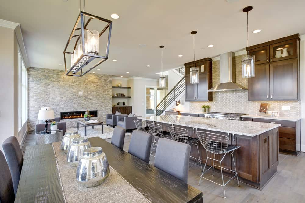 Open concept room in contemporary style with kitchen, large dining area and family room.