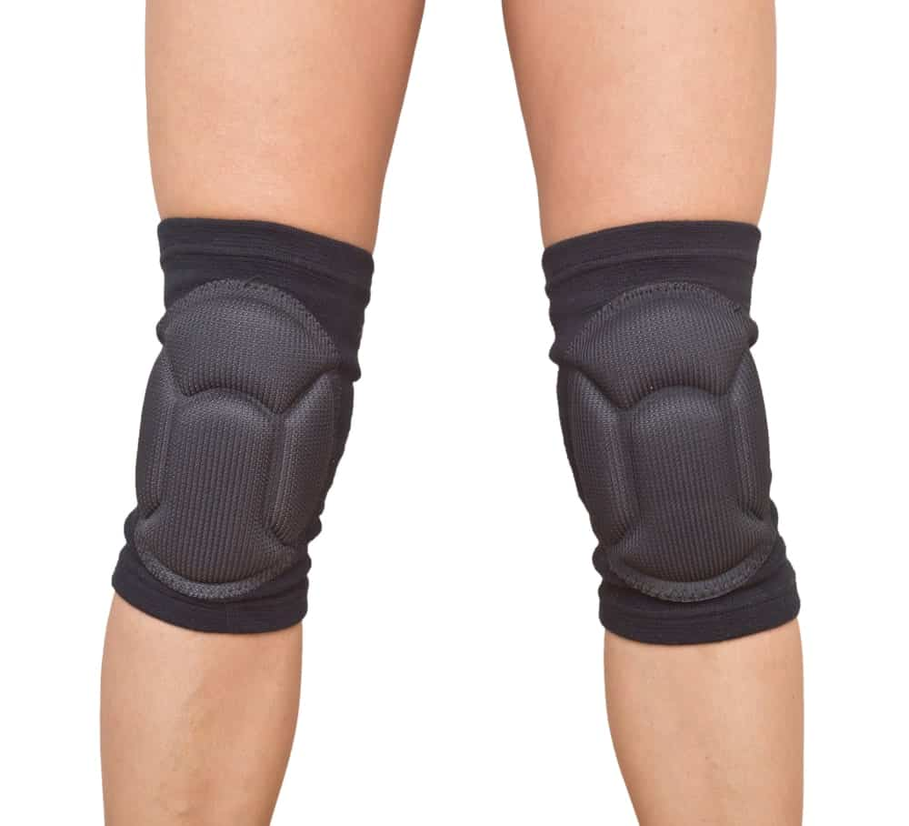 Close up of a woman's legs with knee pads.
