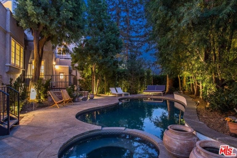 Night time view of the pool area with beautiful landscape on the side.