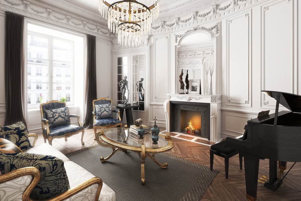 Formal drawing room with high ceiling, fireplace and piano, 3-tier chandelier hanging from the ceiling in the center.