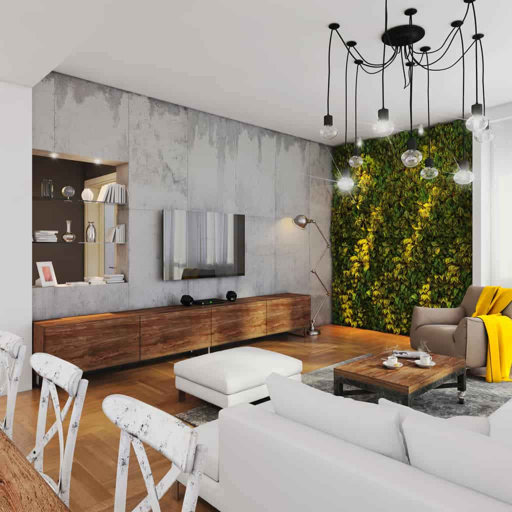 Living room with green plant wall and concrete wall.