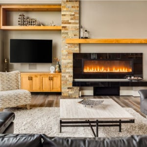 Contemporary living room with wall-mounted TV and gas fireplace