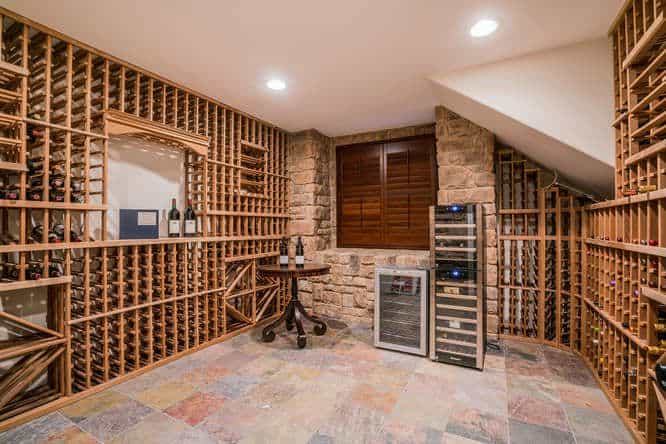 The mansion also has a wine cellar and a bar combo. The wine storage can hold 100+ bottles.