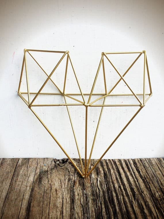 Metallic, heart-shaped geometric wall art in gold.