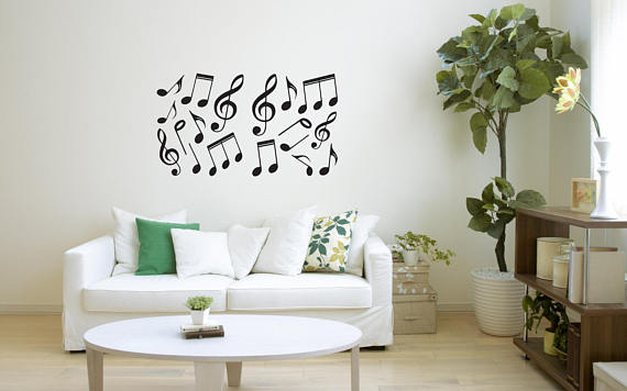 Musical notes in a plain white wall.