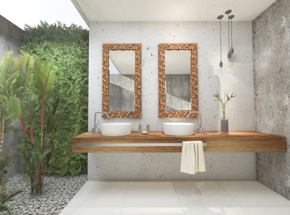 Tropical indoor and outdoor bathroom combo with outdoor shower area in private courtyard.
