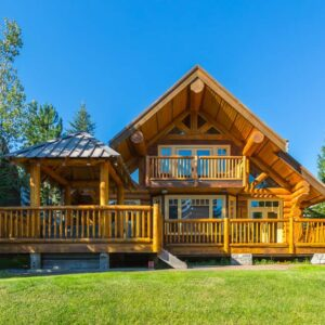 Picture of a large custom log home on beautiful property