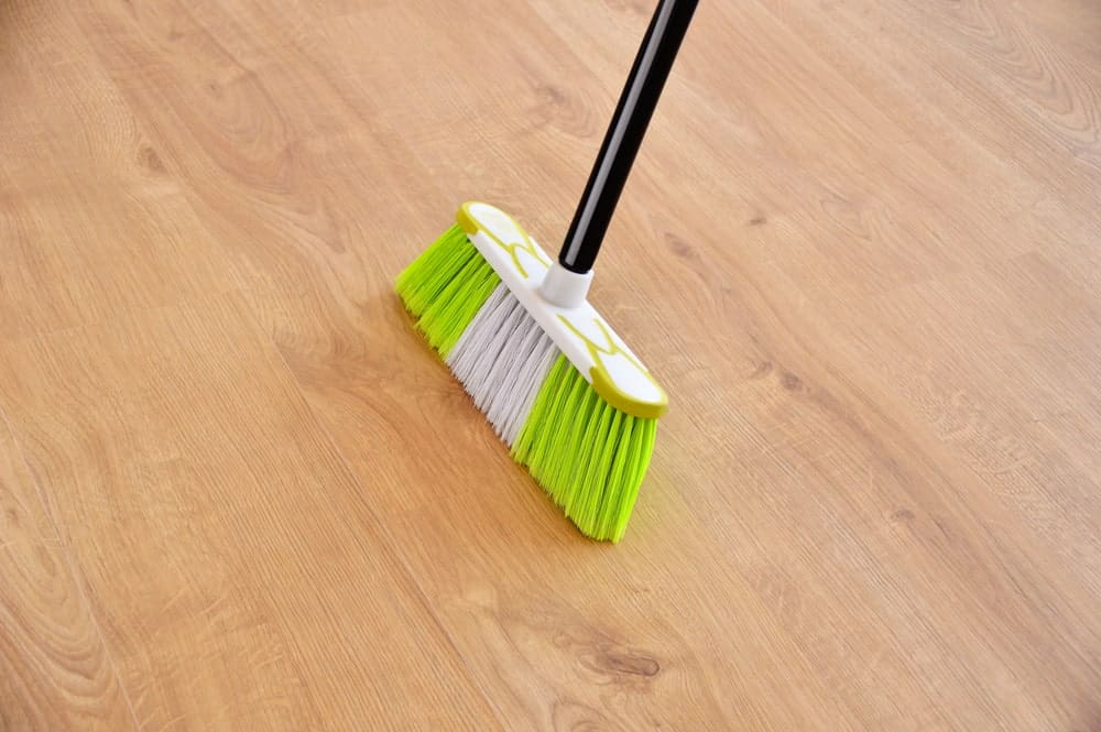 Push broom on hardwood flooring.