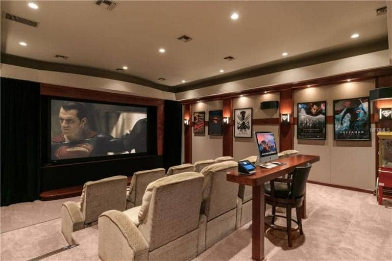 the estates home theater boasts superman films wall decors and sectional theater seating lighted by - Home Theater Design