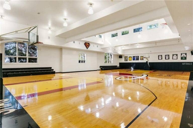 Shaq's home also has a full basketball court with skylight ceiling and Superman logo.