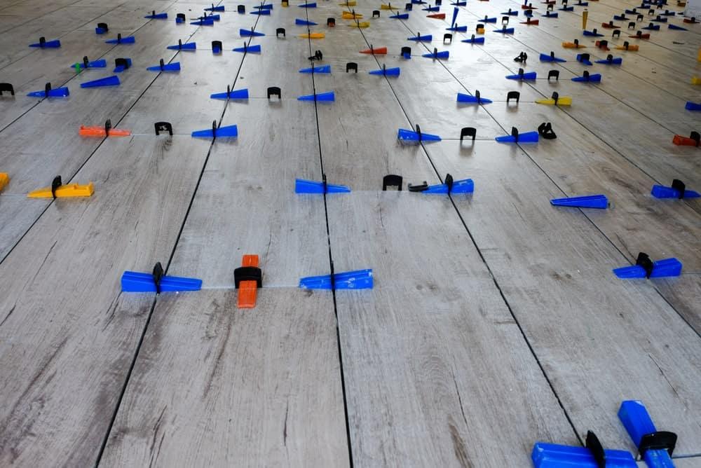 Spacers on hardwood flooring.