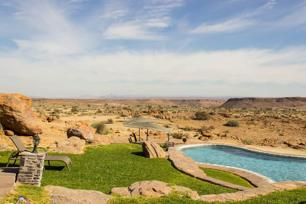 Look how sizzling hot this swimming pool in a desert backyard is.
