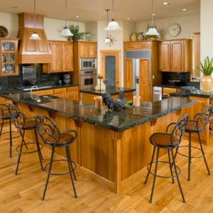 Large l-shaped kitchen island with two levels.