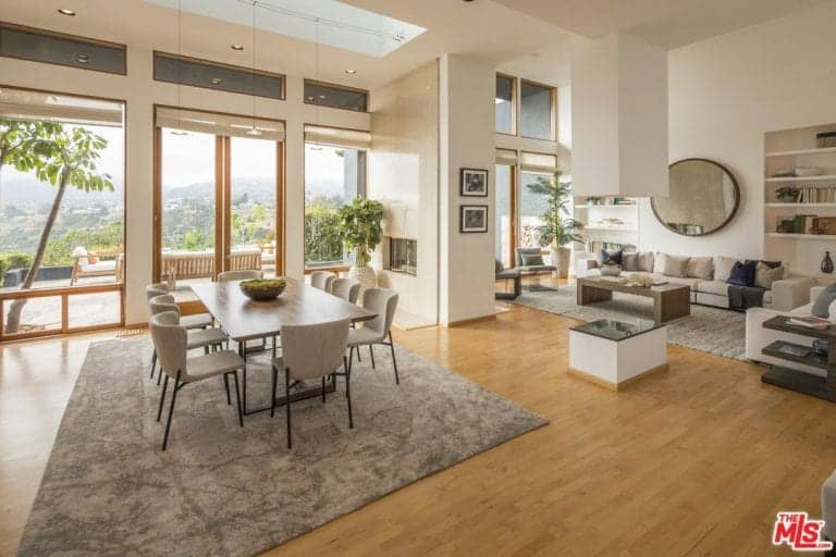 The great room features dining and living room set that are both stylish.