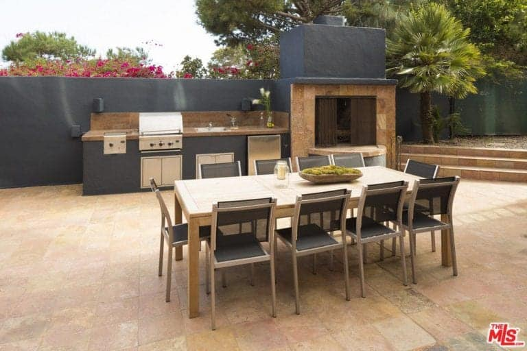 There's also an outdoor kitchen partnered by a dining space.