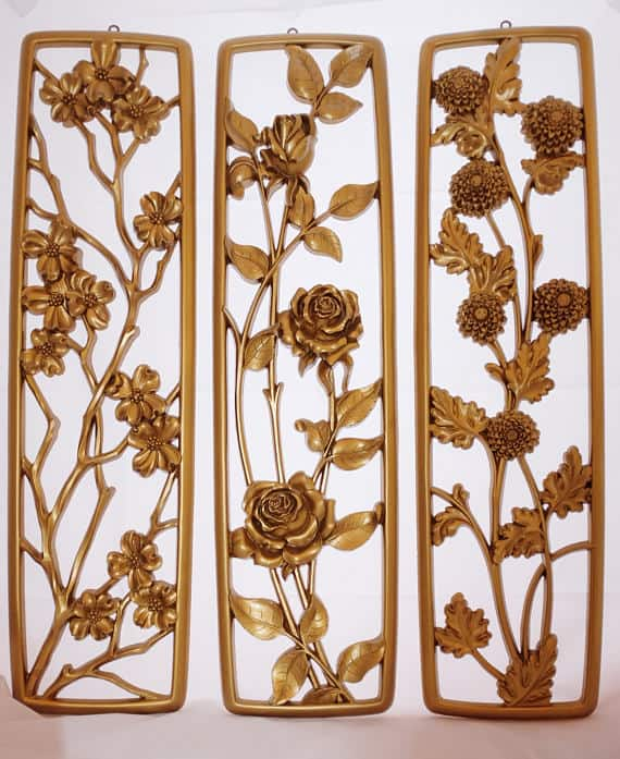 A set of vintage wall arts in gold.