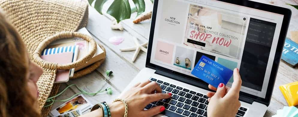 Woman shopping at an online store with credit card