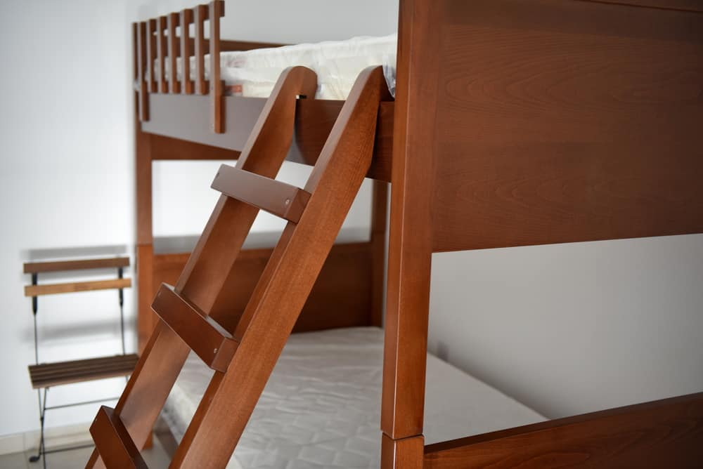 Wooden loft bed or high sleeper.