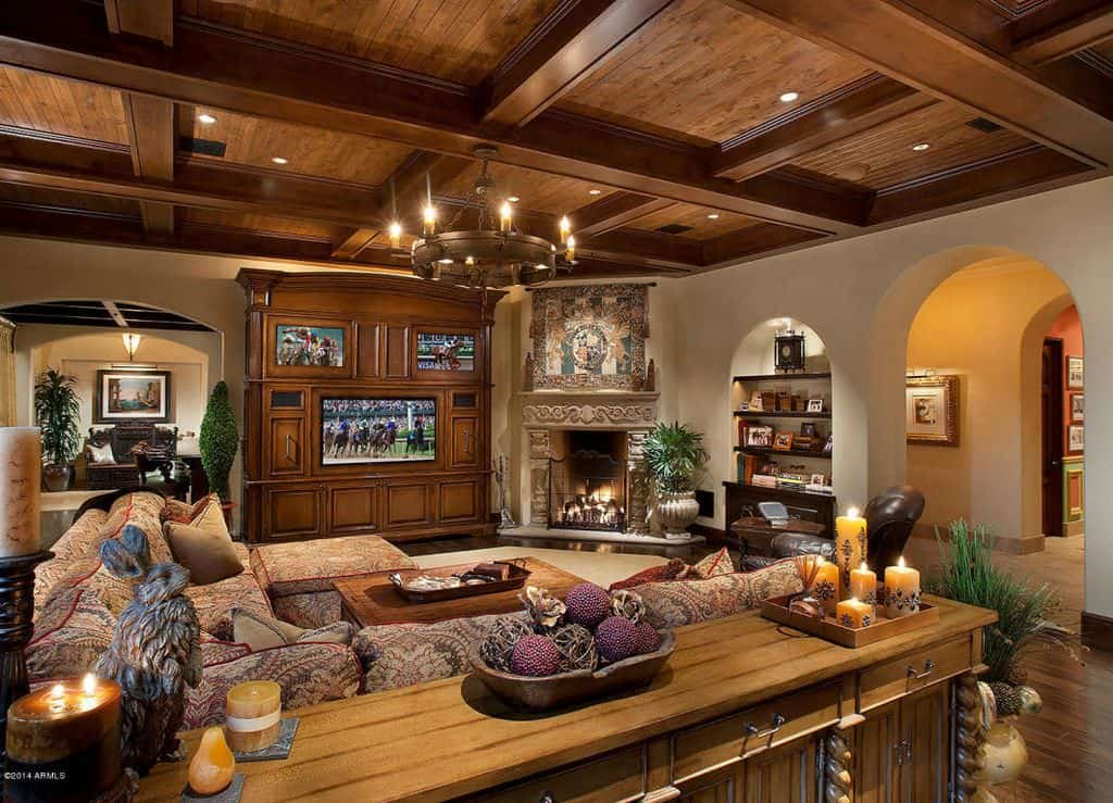 Richly appointed family room with wood coffered ceiling and comfortable sofas.