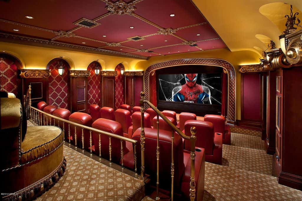 Stadium seating home theater with ruby red leather theater chairs.