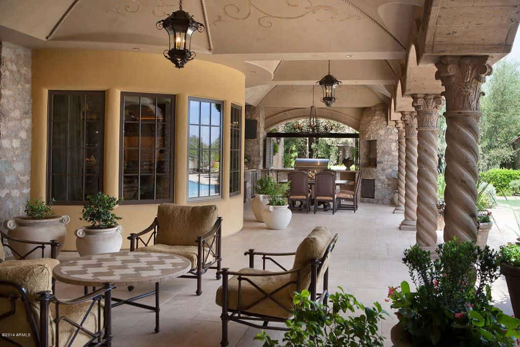 Long covered patio with lounge area and dining area.