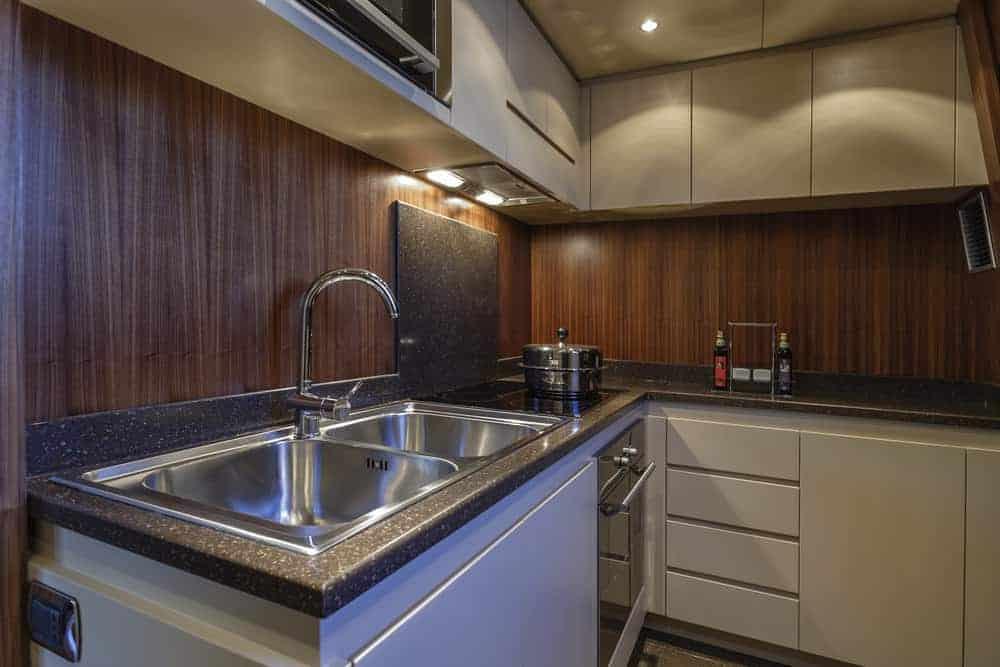 82 foot yacht kitchen white cabinets