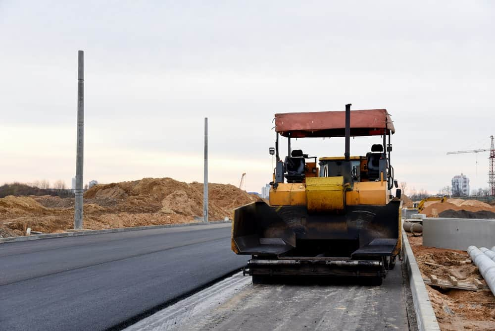 An asphalt road under construction.