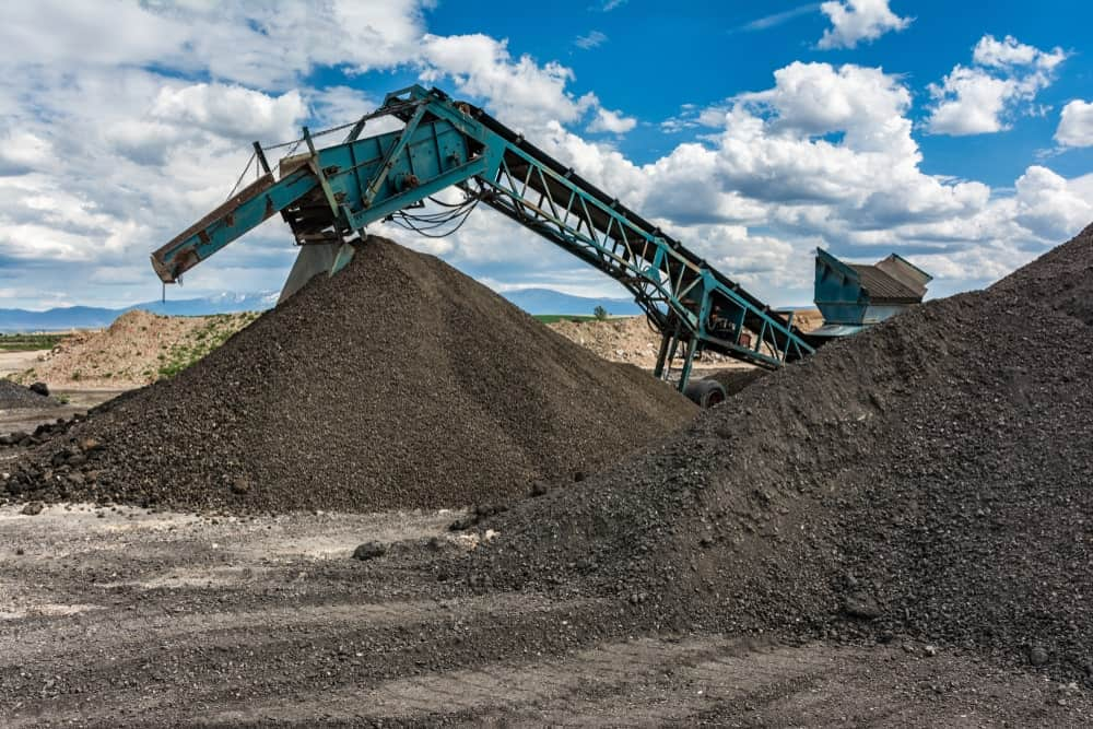 A recycling plant for asphalt being converted to gravel.
