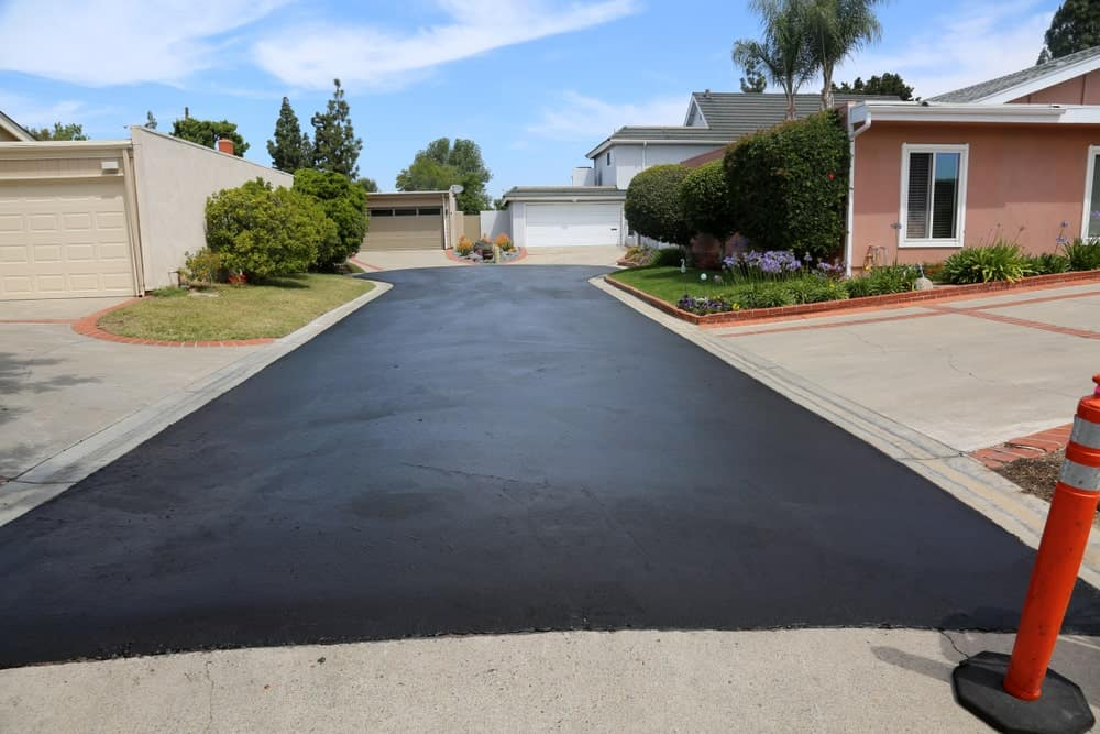 This is a residential suburban street freshly-coated with asphalt.