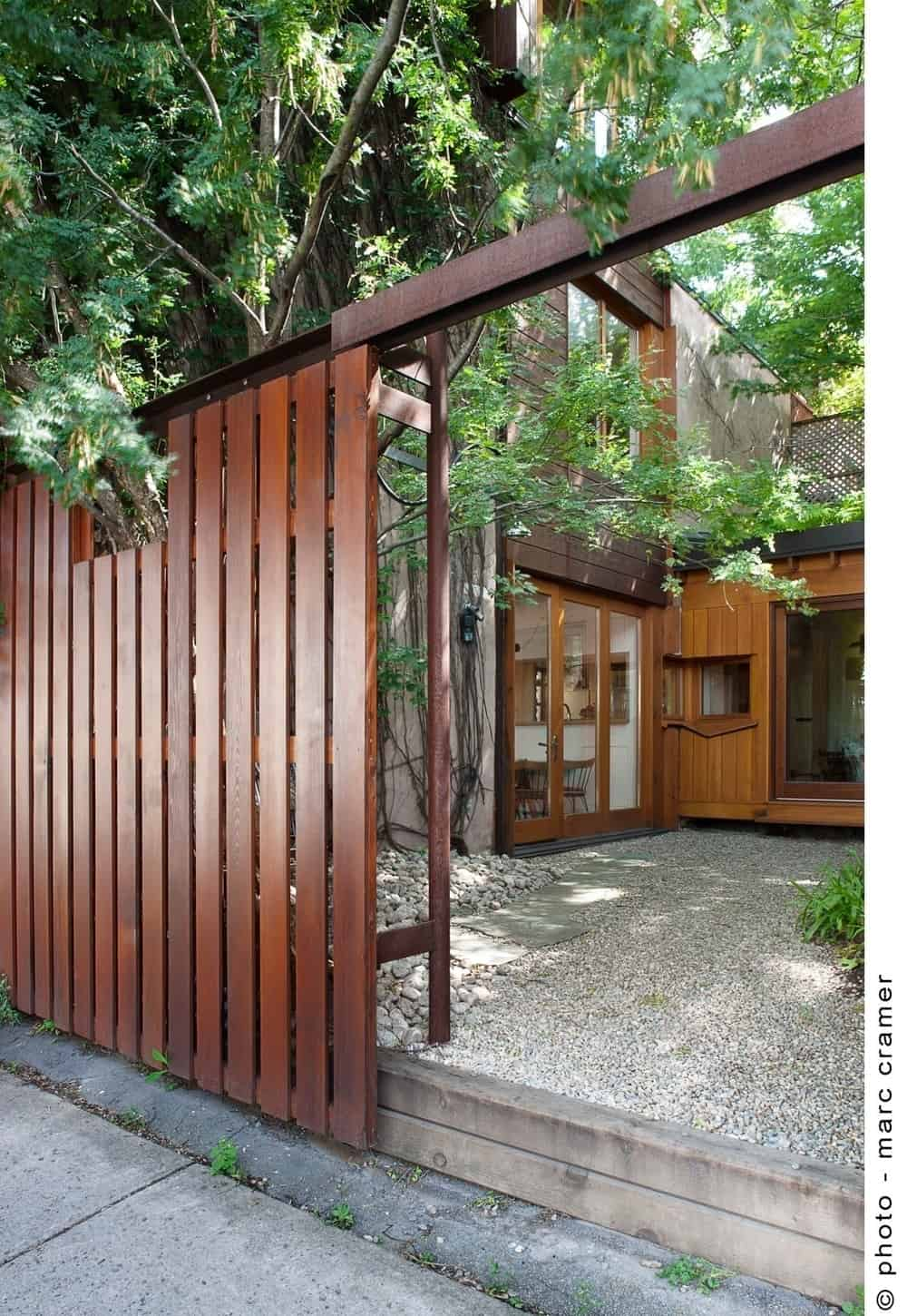 The house features a wooden gate securing the property. Photo credit: Marc Cramer