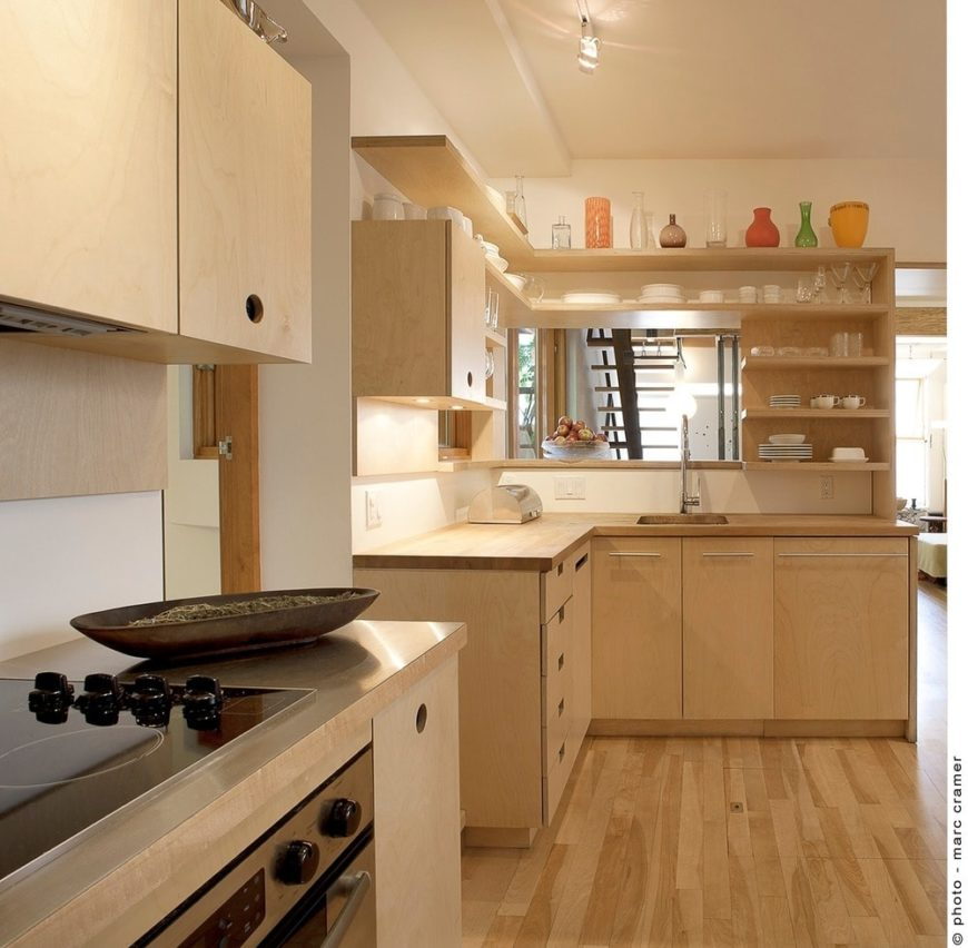 This simple kitchen creates a unified look along with the light wood cabinets and countertops and hardwood flooring.