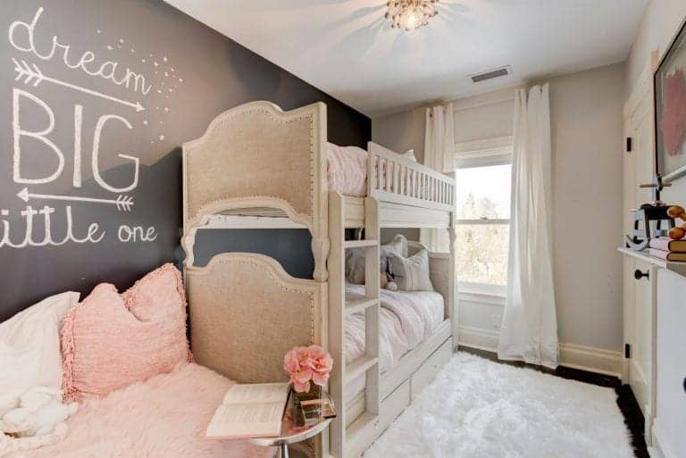 A kids room is also available in the house featuring a stylish wall and a double deck bed.