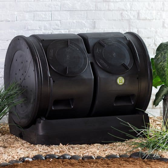 Black, plstic composting bin for outdoor usage.