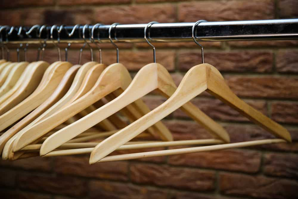 A set of wooden clothes hangers.