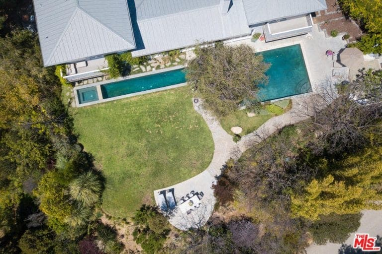 Another aerial view of the house showcasing the perfect landscaping surrounding the house.