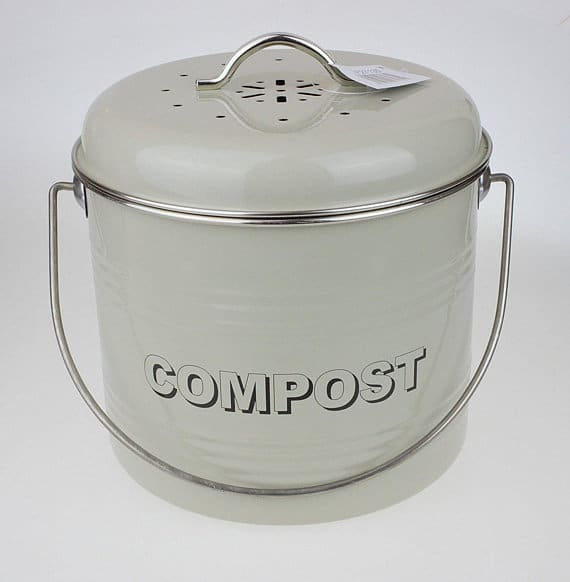 Indoor compost bin with a dirty white shade.
