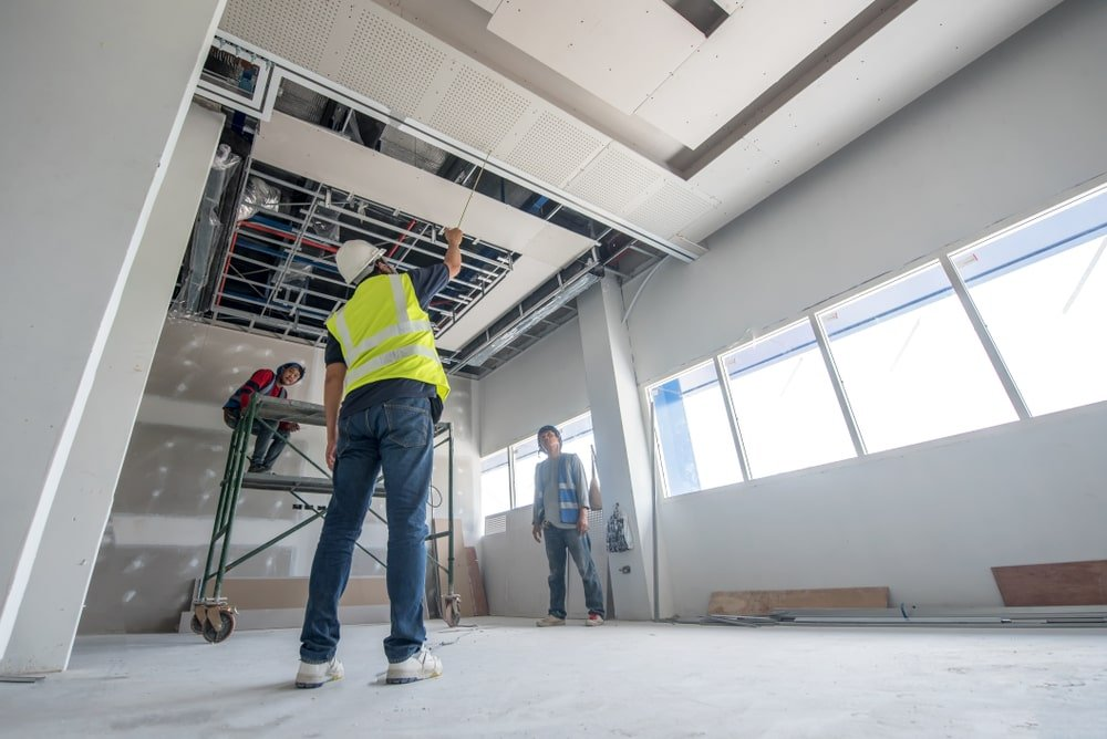 An office space under construction with drywalls.
