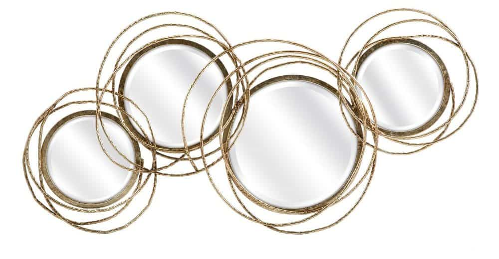 A set of four spherical mirrors with fancy gold frames.