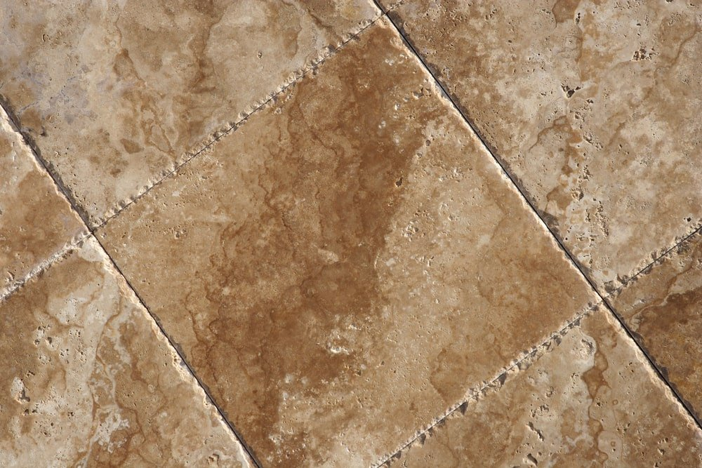 This is a close look at beige marble tiles.